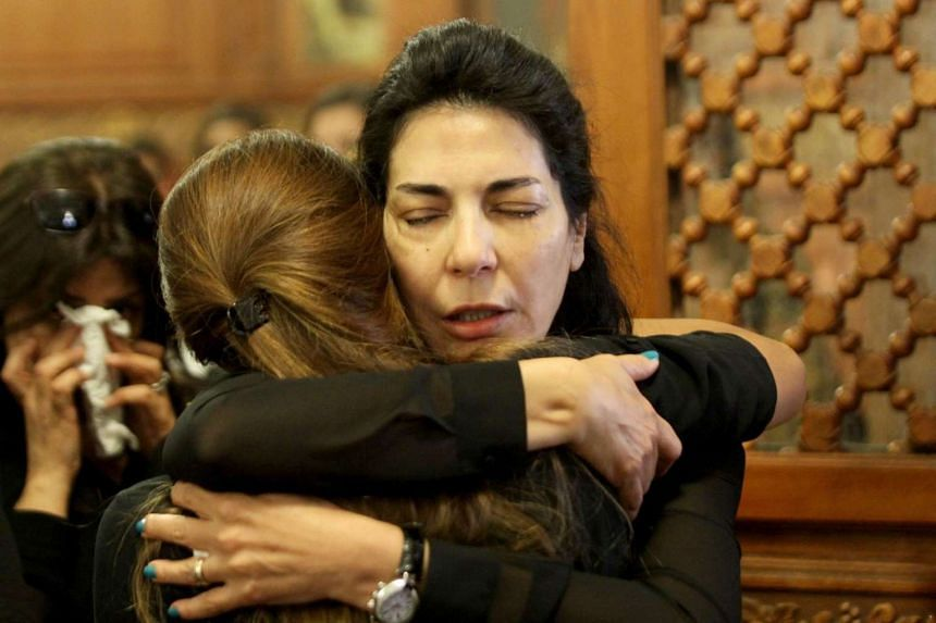 Relatives and friends of EgyptAir hostess Yara Hani mourn during a ceremony at a church in Cairo on May 21, 2016.