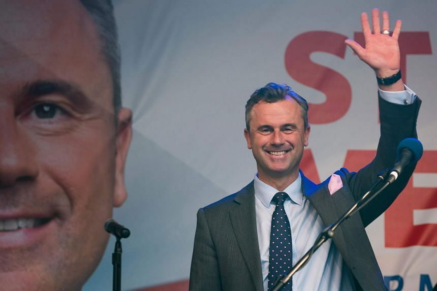 Right-wing Austrian Freedom Party (FPOe) presidential candidate Norbert Hofer waves on stage during Hofer's final election campaign rally at the Viktor Adler Markt in Vienna, Austria.