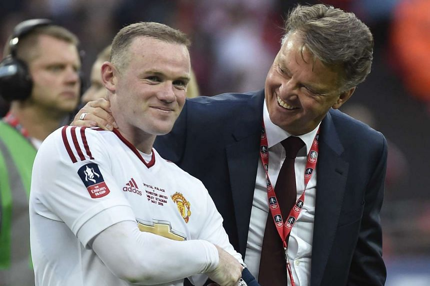 21/5/16 Manchester United manager Louis van Gaal and Wayne Rooney celebrate winning the FA Cup.