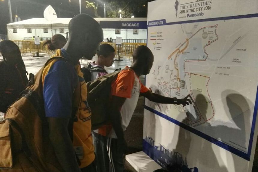 Elite racers from Kenya taking a look at the race route.