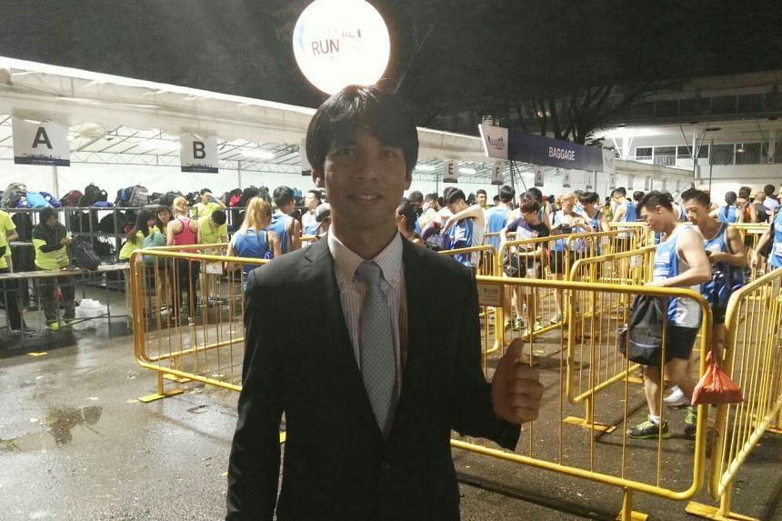 Mr Tsubasa Nakamura will be taking part in this year's ST Run in a suit.