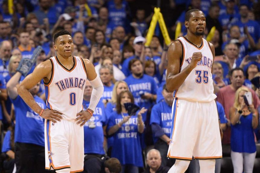 Oklahoma City Thunder's players Kevin Durant (right) and Russell Westbrook during the NBA Western Conference game on May 12, 2016.