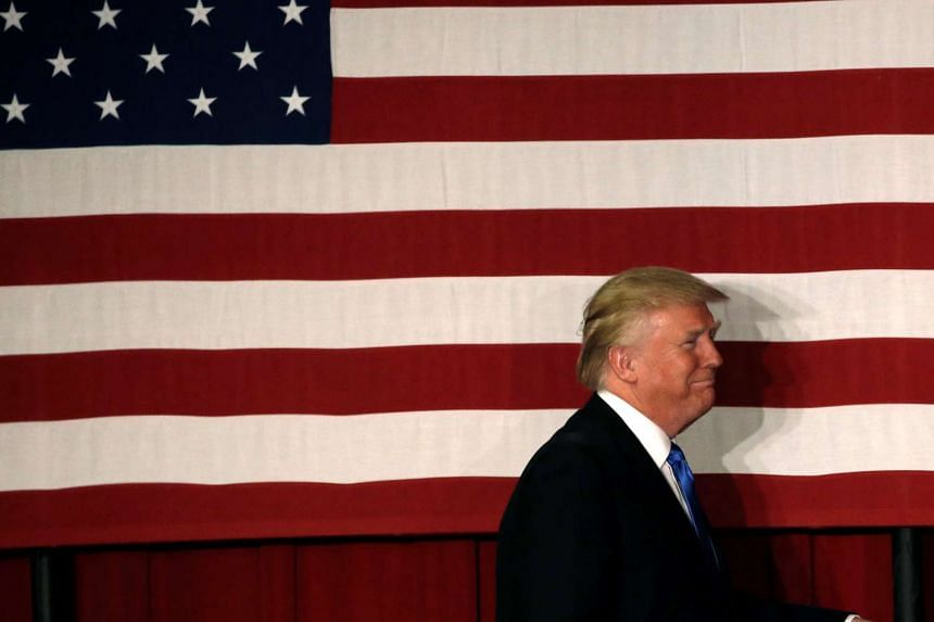 US Republican presidential candidate Donald Trump walks to the stage past an American flag in New Jersey, US on May 19.