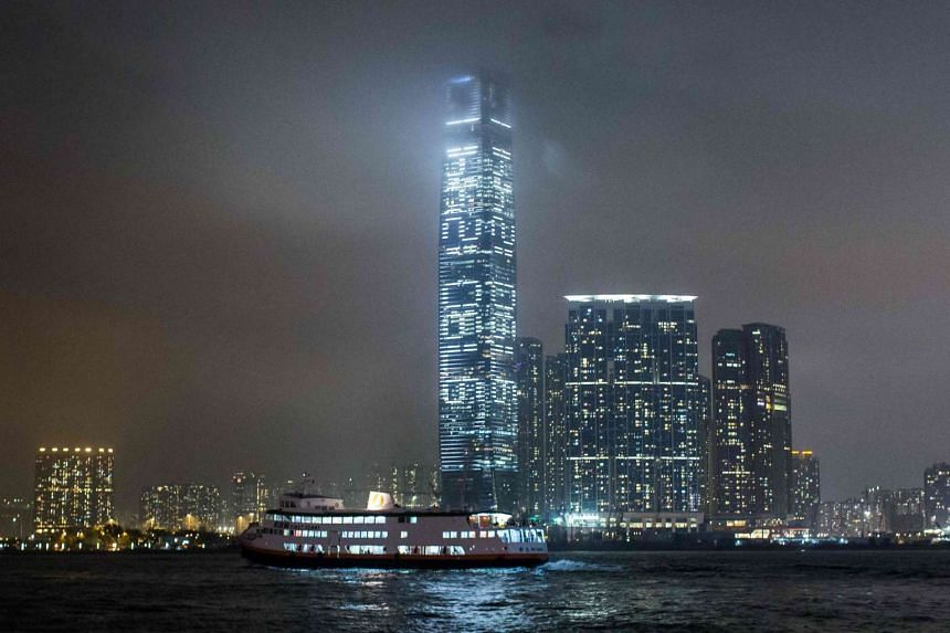 A light show is seen on the facade of the International Commerce Centre, featuring a countdown of seconds remaining until July 1, 2047.