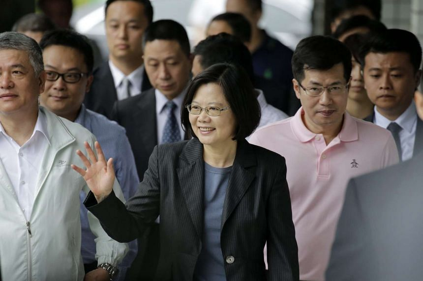 Taiwan President Tsai Ing-wen (centre) waves to supporters as she arrives to vote for party officials in Taipei, Taiwan, on May 22, 2016.