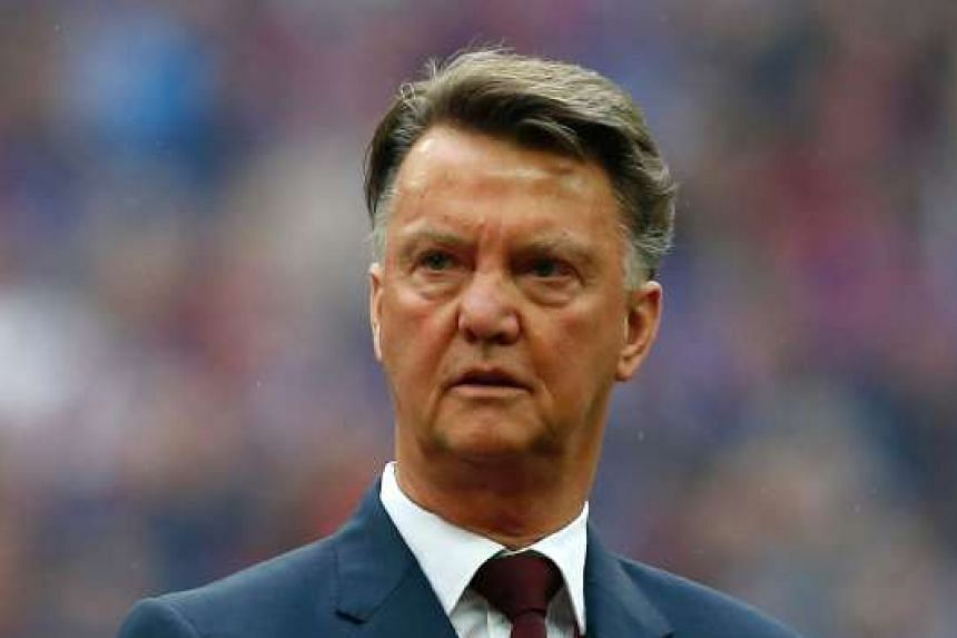 Louis van Gaal lining up on the pitch before the English FA Cup final football match between Crystal Palace and Manchester United, on May 21, 2016.
