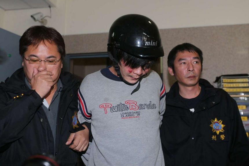 Police escorting Wang Ching-yu on March 28, 2016. Wang allegedly attacked and murdered a Taiwanese toddler along a street in Taipei.