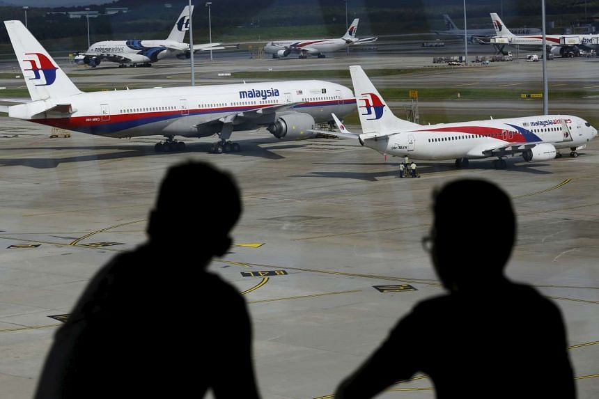 People viewing Malaysia Airlines aircraft at Kuala Lumpur International Airport in Sepang, Malaysia, on March 2, 2016.