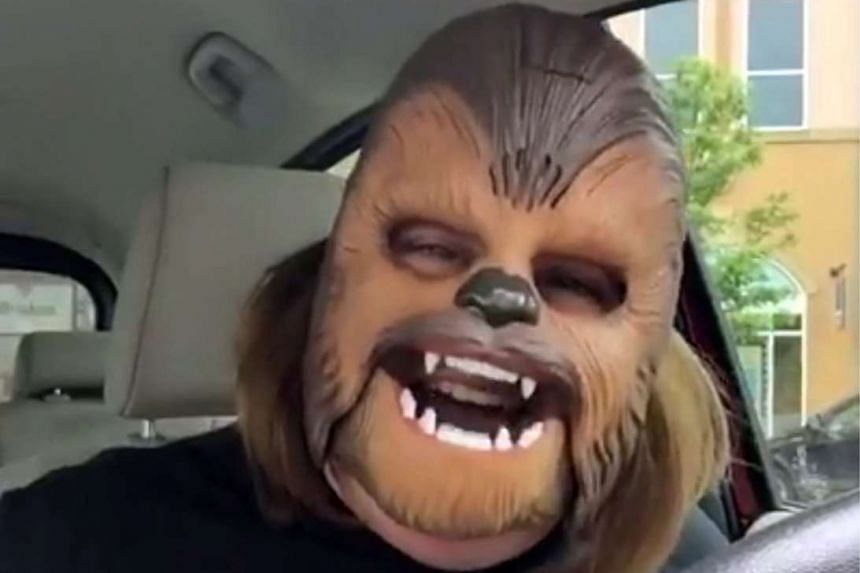 Texas woman Candace Payne uploaded a Facebook video of herself wearing an electronic Chewbacca mask and laughing hysterically.