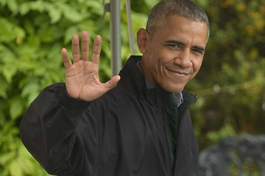 US President Barack Obama waves as he departs the White House for his week-long trip to Japan and Vietnam, in Washington, on May 21, 2016.