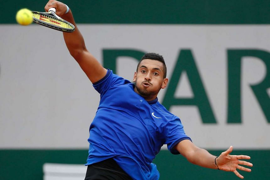 Australia's Nick Kyrgios returns the ball to Italy's Marco Cecchinato during their first round match at the Roland Garros 2016 French Tennis Open in Paris on May 22, 2016.
