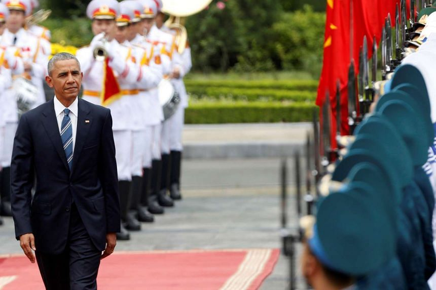 US President Barack Obama reviews the guard of honour during a welcoming ceremony at the Presidential Palace in Hanoi, Vietnam.