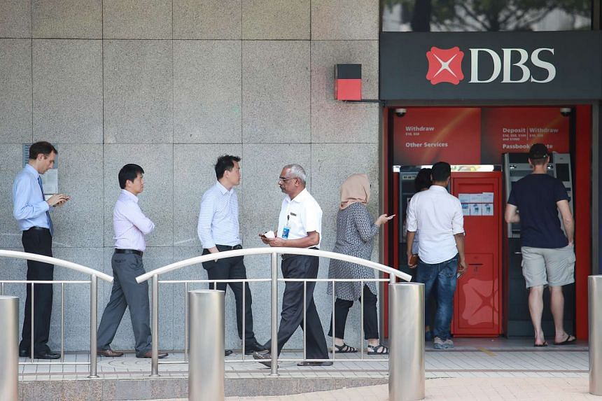 People queuing up at a DBS ATM machine at Raffles Place.