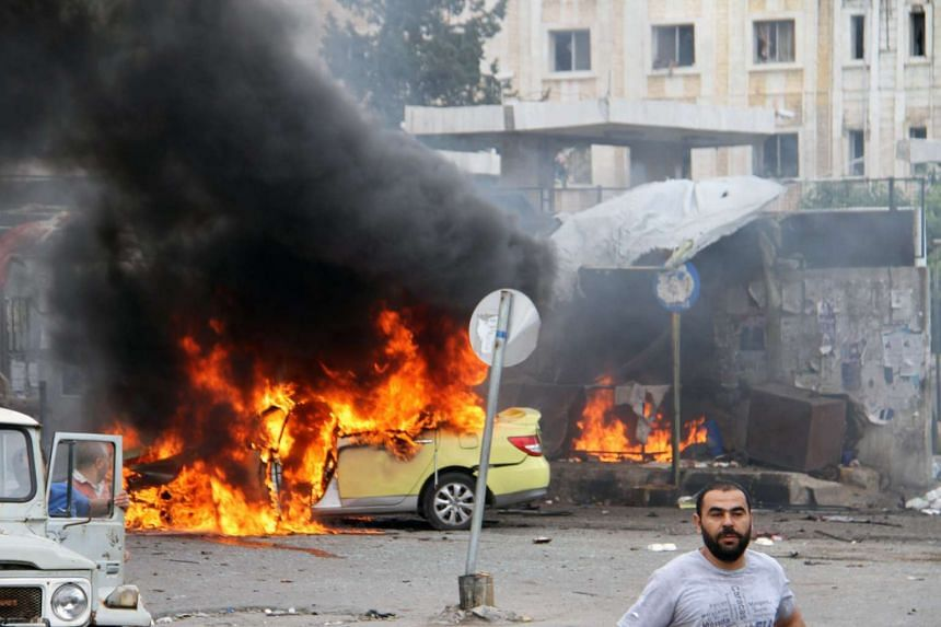 A handout picture released by the official Syrian Arab News Agency (SANA)shows a flames billowing at the scene of multiple bombings in the the city of Tartus, on May 23, 2016.