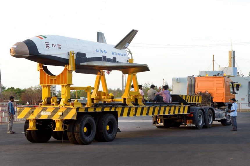 """A scale version of a """"Reusable Launch Vehicle"""" or RLV-TD as it is readied for launch from Sriharikota on the south-east coast of India on May 14, 2016."""