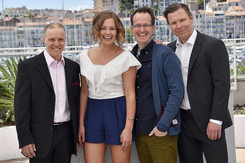 Finnish director Juho Kuosmanen (above, third from left) with the cast of his film, The Happiest Day In The Life Of Olli Maki, (from left) Jarkko Lahti, Oona Airola and Eero Milonoff.