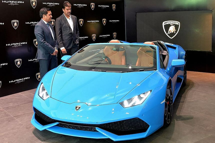Lamborghini India head Sharad Agarwal (left) and managing director of Lamborghini Bangalore T.S. Sateesh with the Lamborghini Huracan 610-4 Spyder during its launch in Bangalore on May 13.