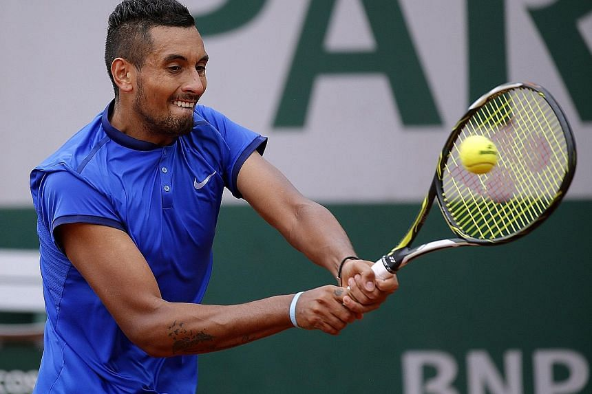 Nick Kyrgios making a backhand return to Marco Cecchinato. He was warned by the umpire for shouting at a ball boy who was slow in handing him his towel and later ranted that top stars are treated differently.