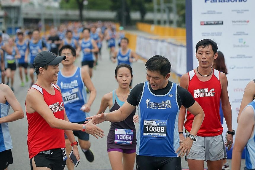 Participants of the 10km race forming a river of blue as they run along the Marina Reservoir at Gardens by the Bay during The Straits Times Run in the City yesterday, now in its fourth year. Construction firm director Tsubasa Nakamura, 41, caught the