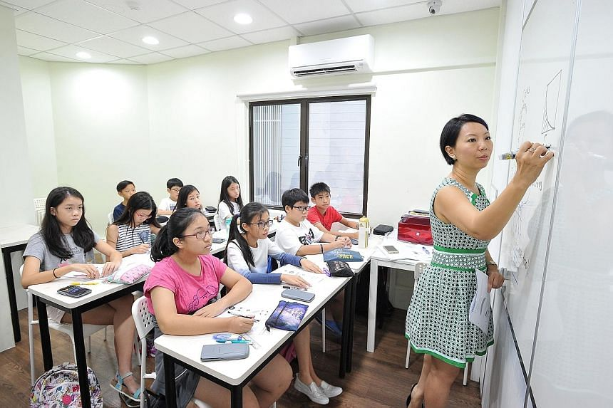 Ms Janice Chuah, 43, teaching a class at Concept Math Education Centre, which she founded. Revenue has hit $1 million a year for the past few years.