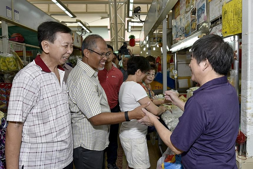Mr Masagos met stallholders and residents during his community visit yesterday to the Eunos ward in Aljunied GRC.