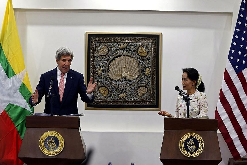 US Secretary of State John Kerry and Myanmar's Foreign Minister Aung San Suu Kyi at a news conference in Naypyitaw, Myanmar, yesterday.
