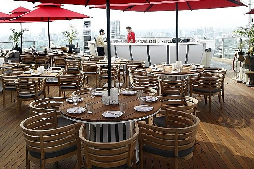 The former Ku De Ta club - now called Ce La Vi - located on the 57th floor of Marina Bay Sands. Mr Au is suing four former business partners and L Capital, the investment arm of LVMH, among others. He said his former business partners got the Hong Ko