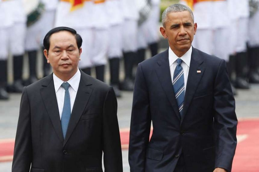 US President Barack Obama walks with his Vietnamese counterpart Tran Dai Quang as they review a guard of honour during a welcoming ceremony at the Presidential Palace in Hanoi on May 23, 2016.