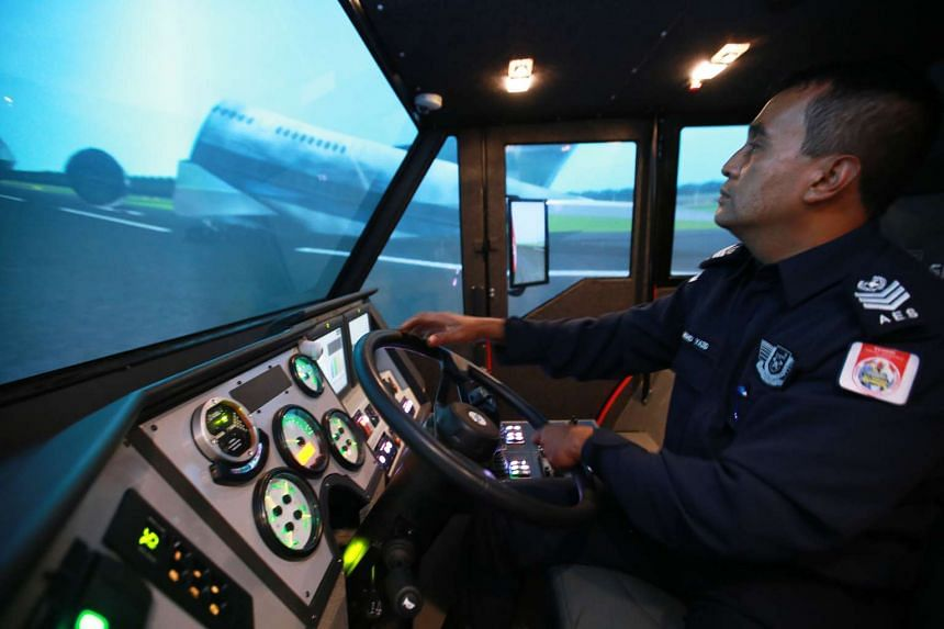 Mr Mohd Yazid, an Airport Emergency Services Officer, is showing a demonstration on the simulator.