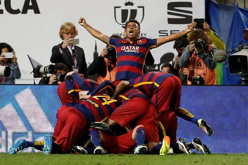Jordi Alba celebrates with team mates after scoring the first goal for Barcelona.