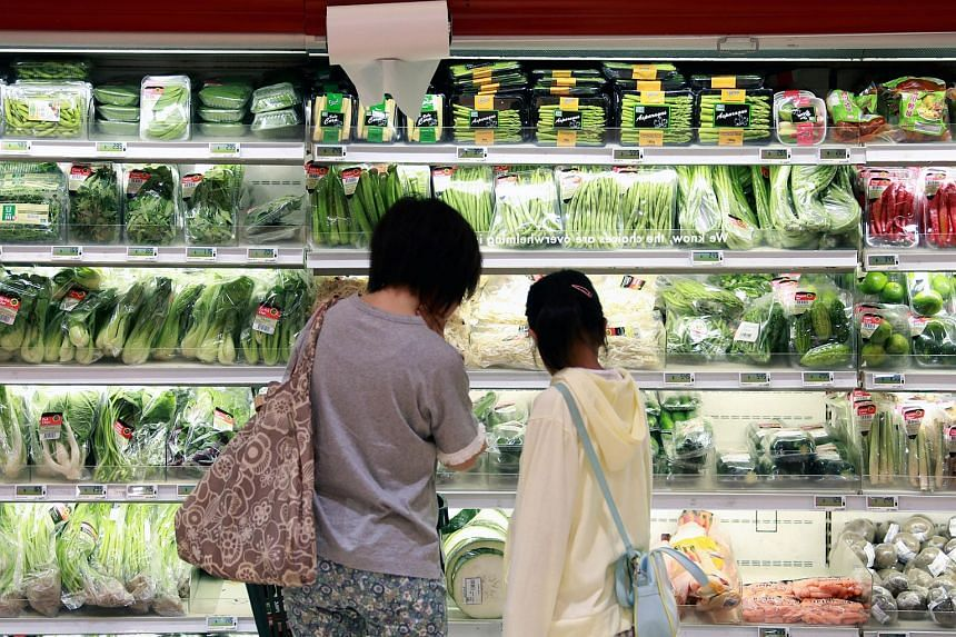 Shoppers browse through the vegetables section at Cold Storage supermarket in Great World City.
