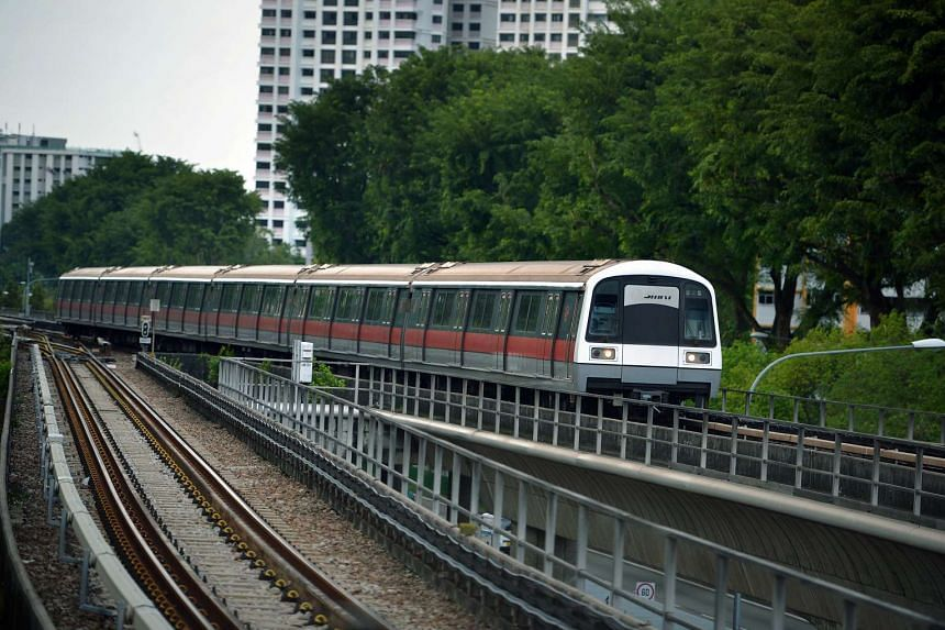 An MRT train on the North-South line approaching Ang Mo Kio station.