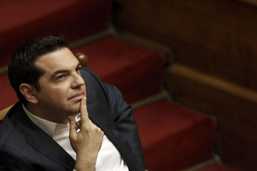 Greek PM Alexis Tsipras attending a parliamentary session, before a vote on a new package of tax hikes and reforms in Athens, Greece, on May 22, 2016.