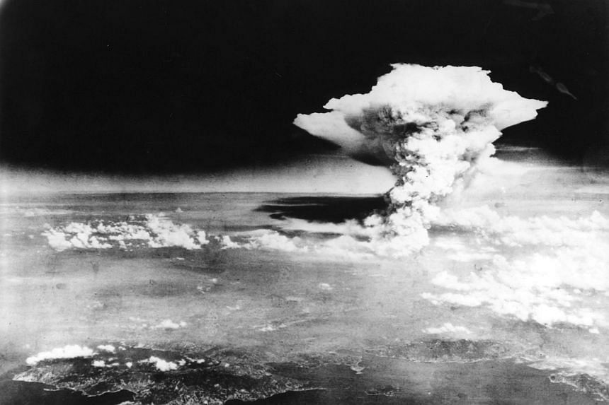 An atomic cloud billows, following the explosion of the first atomic bomb to be used in warfare in Hiroshima.
