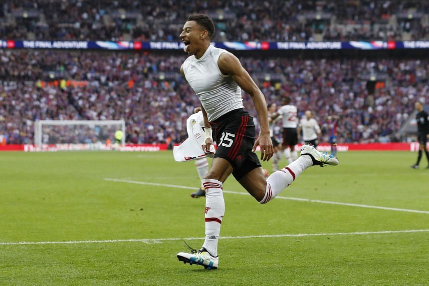 Manchester United's Jesse Lingard celebrates after scoring their second goal.