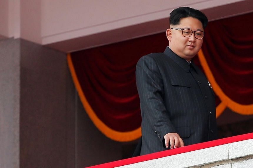 North Korean leader Kim Jong Un looking from the balcony as he presides over a mass rally and parade in the capital's main ceremonial square in Pyongyang on May 10, 2016.