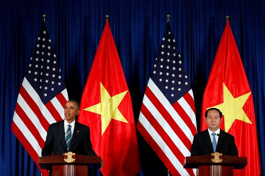 US President Barack Obama attending a news conference with Vietnam's President Tran Dai Quang at the Presidential Palace Compound in Hanoi, Vietnam, on May 23, 2016.