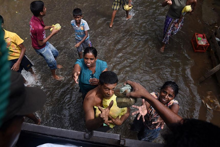 The Sri Lankan army distributes food to flood victims in Kelaniya, on the outskirts of Colombo on May 22, 2016.