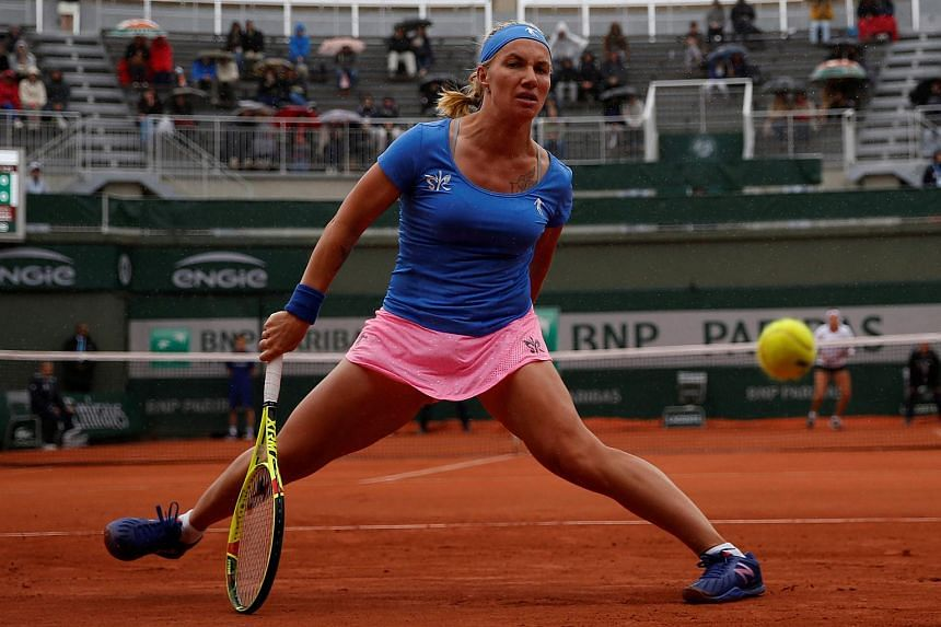 Russia's Svetlana Kuznetsova eying the ball during her women's first round match against Kazakhstan's Yaroslava Shvedova at the Roland Garros 2016 French Tennis Open on May 22, 2016.