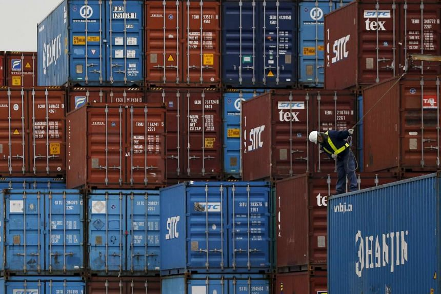 A laborer works in a container area at a port in Tokyo.