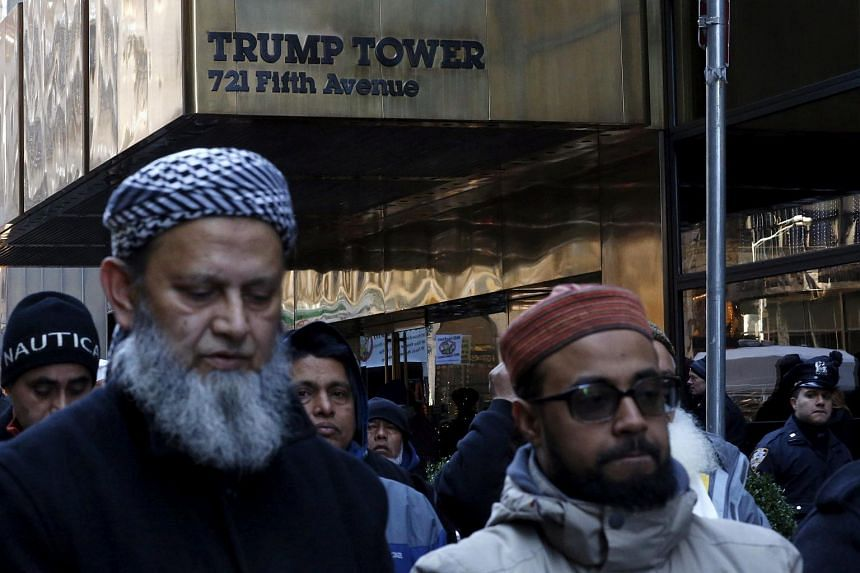 Muslims praying as they take part in a protest against US presidential candidate Donald Trump outside his office in Manhattan, New York, on Dec 20, 2015.
