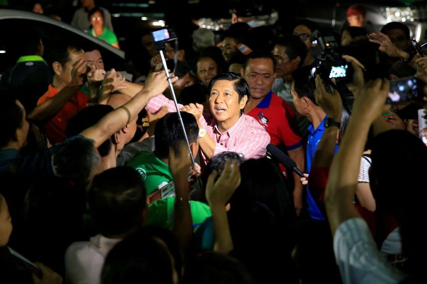 """Philippine vice-presidential candidate senator Ferdinand """"Bongbong"""" Marcos Jr., son of late dictator Ferdinand Marcos, is greeted by members of religious group El Shaddai."""