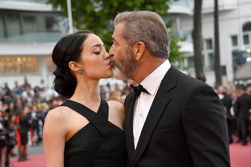 In their rare public appearance together, 60-year-old Mel Gibson walks the red carpet and shares kisses at the closing ceremony with his girlfriend, screenwriter Rosalind Ross (both above).