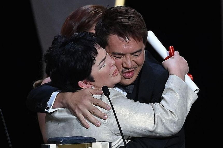 Actress Jaclyn Jose (left, with director Brillante Mendoza) received the Best Performance by an Actress award for Ma' Rosa.