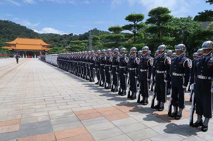 Honour guards lining up outside the National Revolutionary Martyrs' Shrine in Taipei yesterday as President Tsai visited the memorial.