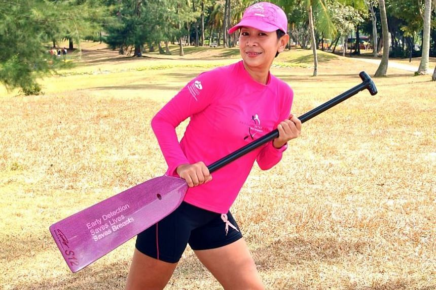 Ms Chui enjoys the team camaraderie and adrenaline rush of a dragon boat race.