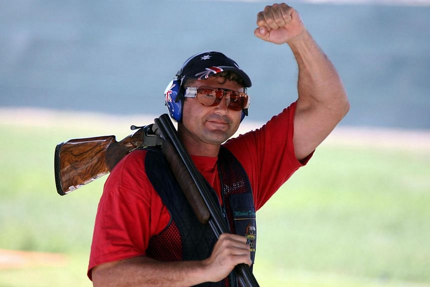 A file photograph shows Australian double Olympic gold medalist Michael Diamond celebrating on his way to winning the trap event of the ISSF World Shooting Championships.
