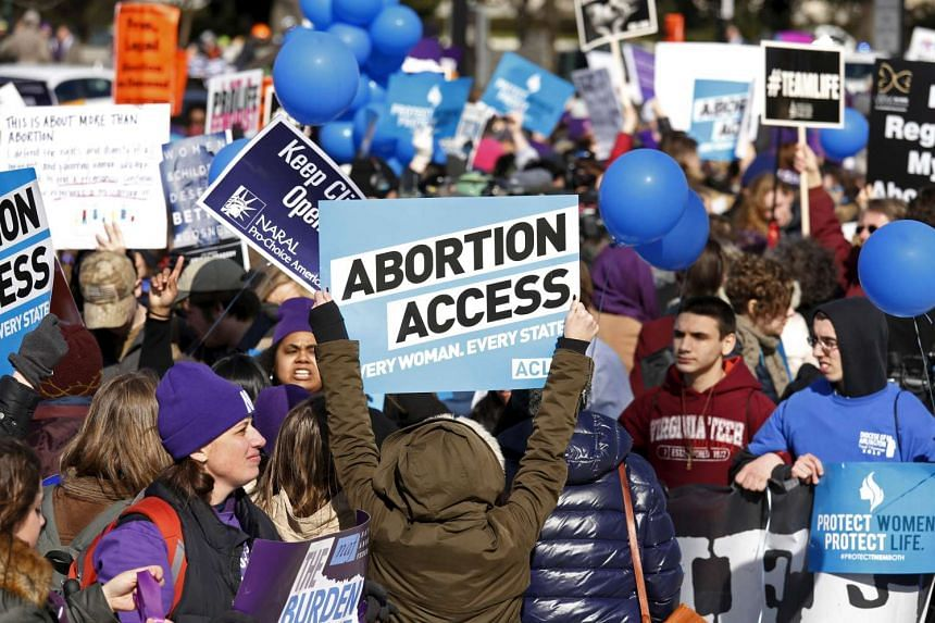 Protesters demonstrate before the US Supreme Court during a major abortion case focusing on a Texas law that imposes regulations on abortion, in Washington, March 2, 2016.