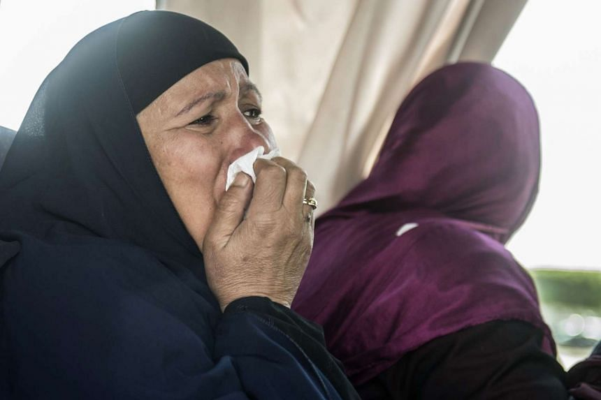 A relative of a passenger who was flying aboard the EgyptAir plane that vanished from radar en route from Paris to Cairo cries at Cairo airport on May 19, 2016.
