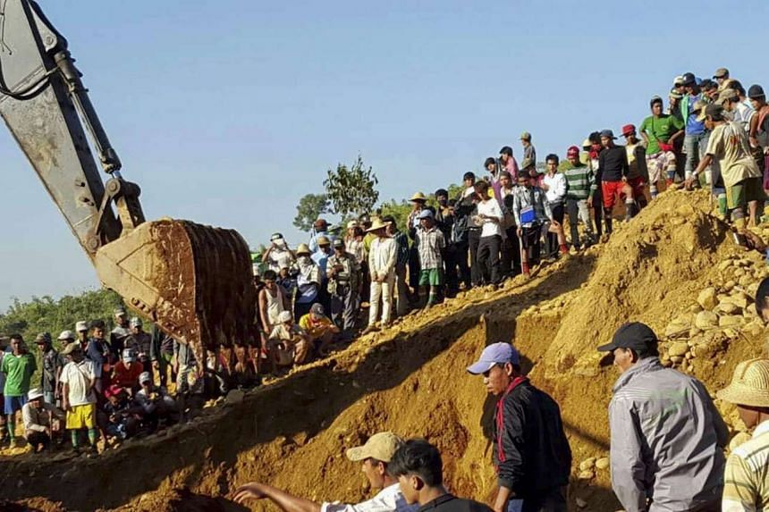 People searching for miners killed by a landslide at Hpa Kant jade mining area in Myanmar, on Nov 22, 2015.